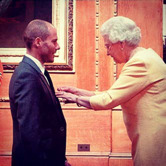 Rob Law presented with an MBE by Her Majesty the Queen